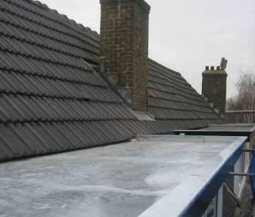 vervangen van zinken platte dak